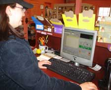 Traditions employee working the CRE register